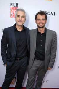 """Academy Award-winner Alfonso Cuaron with his son, """"Desierto"""" director Jonas Cuaron at the film's Los Angeles premiere. Photo courtesy of STX Entertainment/AP Images)"""